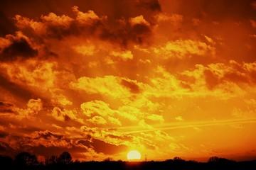 Foto auf Gartenposter Ziegel Silhouette Landscape Against Orange Cloudy Sky At Sunset