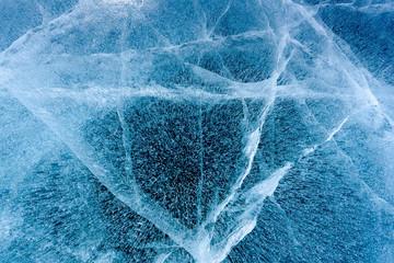 Beautiful ice of Lake Baikal with abstract cracks