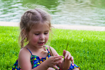 Little Girl Playing With Pine Needles, Dallas,Texas, USA