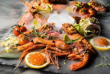 Poster Appetizer shrimps on stone plate