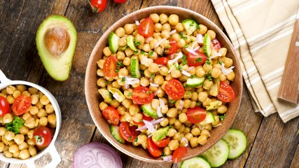 Fototapete - chickpea salad with avocado, tomato and onion