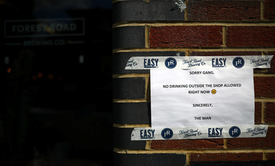 Sign informs customers they aren't permitted to drink outside in Hackney, London