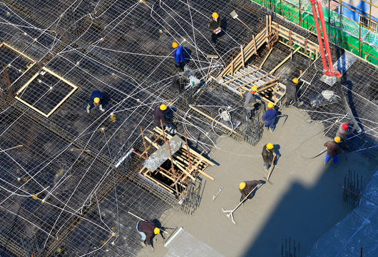 Many workers are working at the construction site