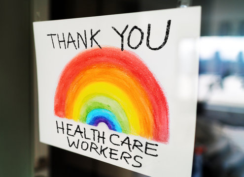 THANK YOU Healthcare workers child's painting hanging at window as appreciation support message for doctors and nurses fighting COVID-19 at hospitals.