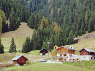 Foto auf Gartenposter Khaki Houses On Countryside Landscape