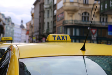 Bright yellow taxi in evening city