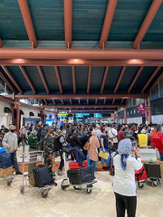 A crowd of people with luggages stand in line at Soekarno-Hatta International Airport, during the outbreak of the coronavirus disease (COVID-19) in Tangerang