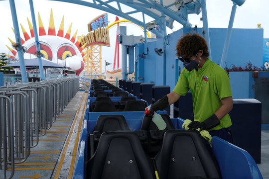 A worker cleans a roller coaster cart at Ocean Park theme park, which is currently closed due to the coronavirus disease (COVID-19), in Hong Kong