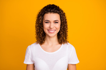 Closeup photo of attractive charming lady beaming smile pretty brown small curls hairstyle wear...