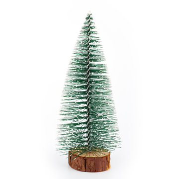 Lovely fake mini Christmas tree, which is not decorated over white background. Little christmas tree