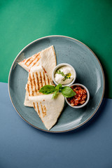 Chiken quesadilla topping sauce cream salsa tomato mint dish grill grilled