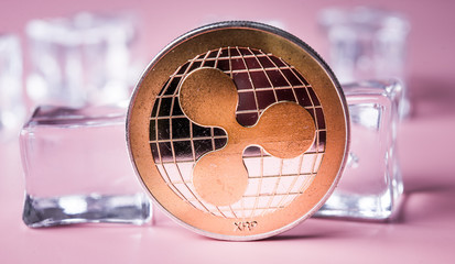 Golden ripple coin. Crypto XRP Coin on light background. Close-up, macro shot.New Virtual Money