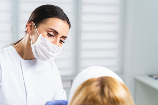 Concentrated doctor looking at her female patient
