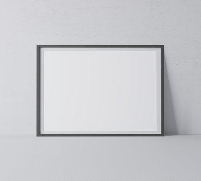 Black horizontal frame mock up. Frame poster standing on gray floor. 3D illustrations.