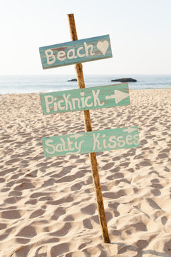 Wooden sign on a beach.