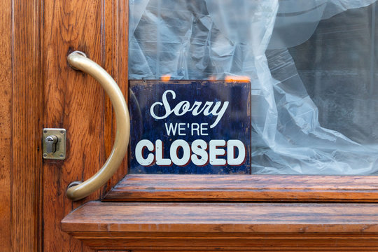 Sorry, we are closed - board on cafe/ restaurant/shop window, closed shut down business during coronavirus pandemic, covid-19 outbreak. Lockdown, isolation, small business bankruptcy concept.