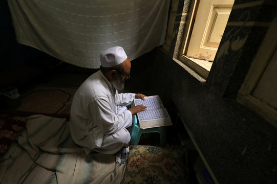 Man reads Koran during Ramadan as COVID-19 continues, in Peshawar