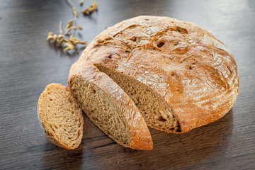 Fototapeta Fresh bakery, sliced bread on a wooden backround obraz