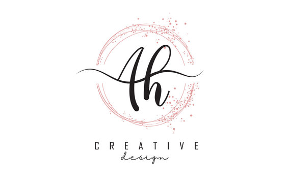 Handwritten AH a h letters logo with dust pink sparkling circles and glitter.