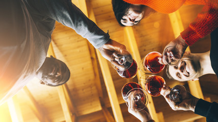 Multiracial Happy friends having fun indoors, Young people enjoying wine time together in a farmhouse vineyard countryside, Youth and friendship concept image