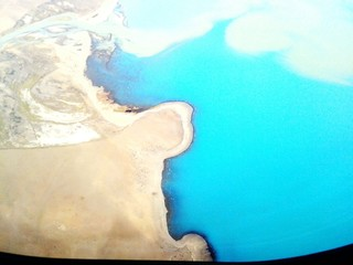 View Of Coastline From Airplane Window