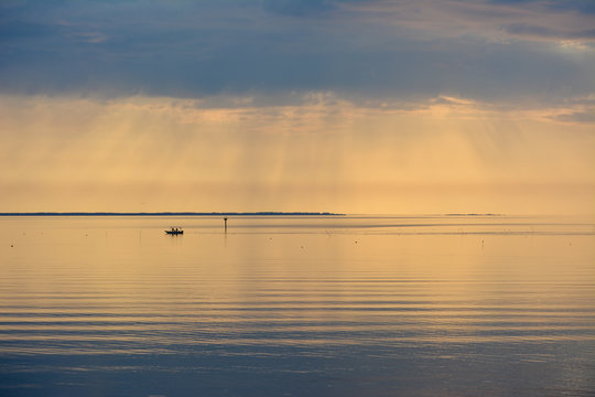 Fishing boat working crab pots during a beautiful sunrise over the Chesapeake Bay.