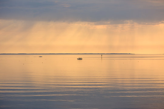 Two fishing boats checking crab pots during a beautiful sunrise on the Chesapeake Bay.