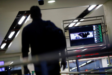 A man is seen through a thermal camera used to detect high body temperatures among departing passengers at the President Juscelino Kubitschek International Airport, amid the spread of the coronavirus disease (COVID-19), in Brasilia