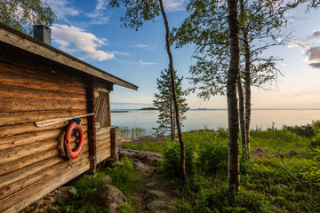 Landscape with finnish sauna building and the gulf of Bothnia on background