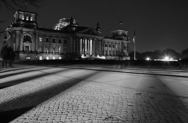 Cobblestones Street At Night With Large Building In Background Fototapete