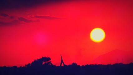 Foto auf AluDibond Rot Silhouette Landscape Against Romantic Sky
