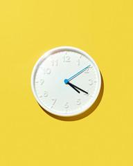 White Four-Twenty Clock Isolated on Yellow Background