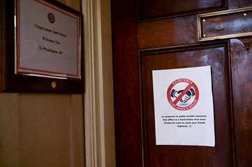 A sign posted outside the office of Rep. Graves asks visitors not to shake hands on Capitol Hill in Washington