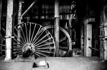 Rusty Wheels In Abandoned Factory