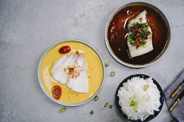 Steamed Fish Flounder in soy sauce and Curry saffron sauce, top view