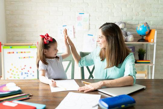 Mom and girl enjoying homeschool together