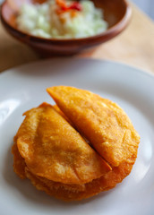 Belizean Food, Panades With Onion Sauce On A White Plate