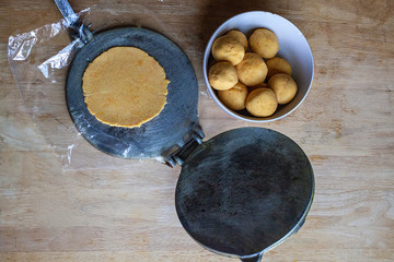 Belizean Food, Panades in the making. Corn dough on wooden surface.