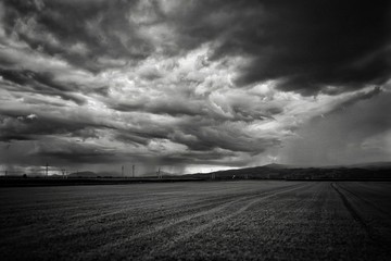 Scenic View Of Agricultural Field Against Cloudy Sky Fototapete