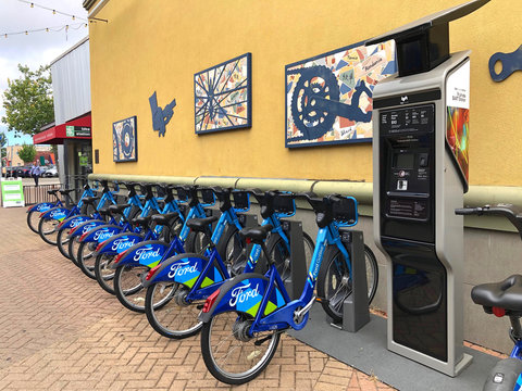 Fruitvale, CA - June 26, 2019: Blue Go Ford shared bikes lined up in the at Fruitvale BART station with a lyft machine. The Bike Share has over 70 stations and 700 bikes throughout the Bay Area.