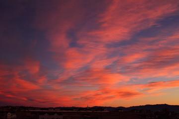 Fototapeten Hochrote Scenic View Of Landscape Against Orange Sky