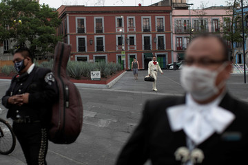 Mariachis wait for customers at Plaza Garibaldi while protesting to be allowed to perform at the location and get access to governmental financial aid due to the ongoing outbreak of the coronavirus disease (COVID-19), in Mexico City