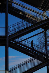 Stockholm, Sweden People walking on stairs below the Liljeholmen bridge.