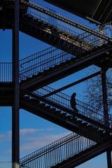 Stockholm, Sweden People walking on stairs below the Liljeholmen bridge.