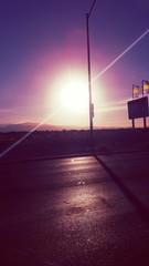 Foto auf AluDibond Violett Landscape Against Sky On Sunny Day
