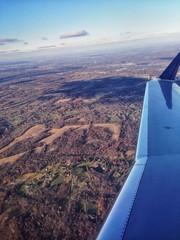 Foto auf AluDibond Lavendel Cropped Image Of Airplane Flying Over Landscape