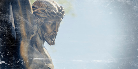 Fotomurales - Retro styled statue of the crucifixion of Jesus Christ in profile. Horizontal image.
