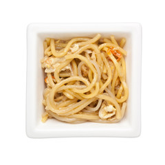 Asian cuisine - Stir fried noodles in a square bowl isolated on white background;