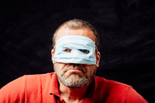 Adult man wearing face mask superhero style