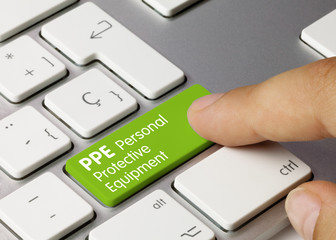 PPE Personal Protective Equipment - Inscription on Green Keyboard Key.
